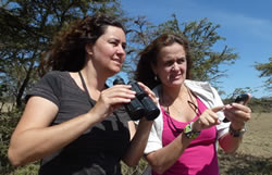 Junia Machado and Ana Zinger contribution elephant observations while visiting Maasai Mara. Photo: ElephantVoices.