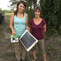 Scientist, Jen Guyton, and Joyce contemplate why an elephant might have decided to destroy solar equipment used to power Jen's motion triggered camera. ©ElephantVoices.