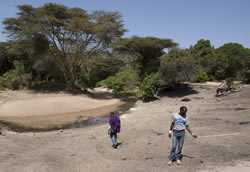 Looking for elephant signs at salt lick near Walking with Maasai/Olkoroi Camp, with Amos Munai and Parit Kashu.