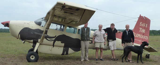 Preparing to fly with Iain Dougland-Hamilton and Richard Roberts - Marc Goss and his big dog also pictured. (©ElephantVoices)