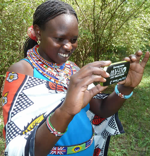 Agness Kilena, guide at Basecamp Masai Mara working with the Mara EleApp. (©ElephantVoices)