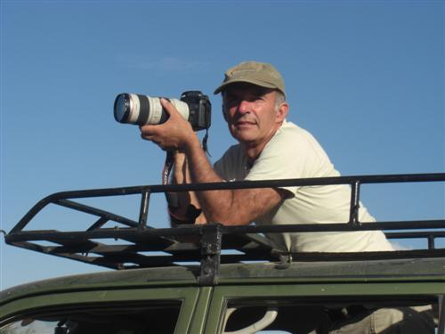 Petter  taking photos through roof hatch. (©ElephantVoices)